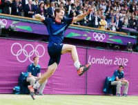 Andy Murray of Britain jumps for joy after