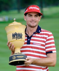 Keegan Bradley holds the trophy after winning