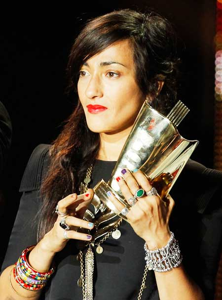 Moroccan singer Hindi Zahra holds her award in the category