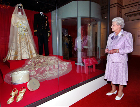 Britains Queen Elizabeth II Looks At Her 1947 Wedding Gown