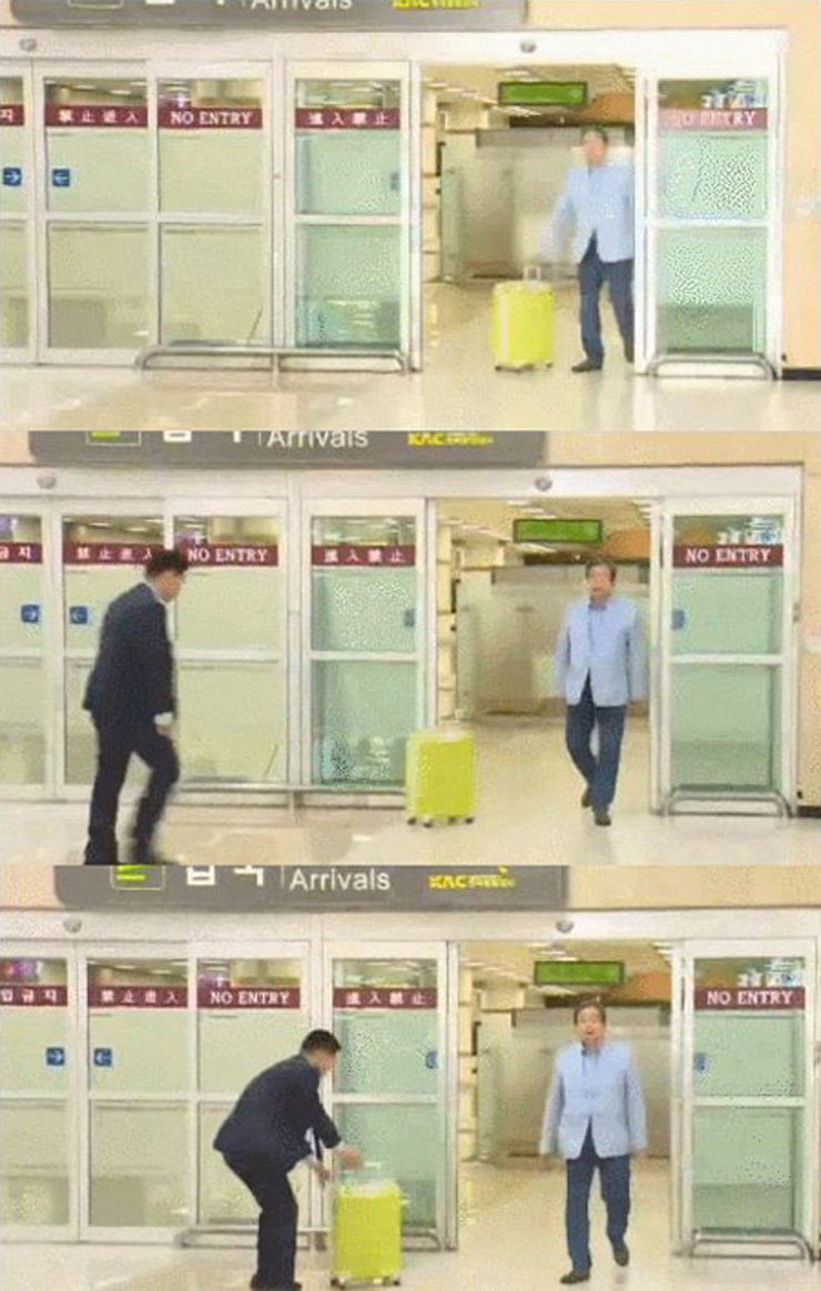 Kim pushed his luggage bag to his assistant, without a glance, at Gimpo International Airport on Tuesday. / Screen capture from Kim Kwang-jin's Facebook