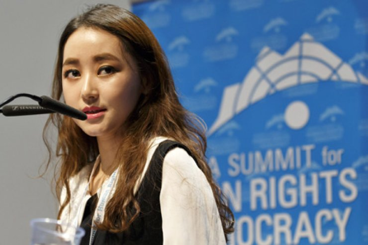 Park Yeon-mi, a North Korean defector, speaks at a conference in Geneva, Tuesday, to promote human rights in North Korea. Since escaping North Korea to China in 2007, Park has travelled the world working as a civil rights activist. / EPA-Yonhap