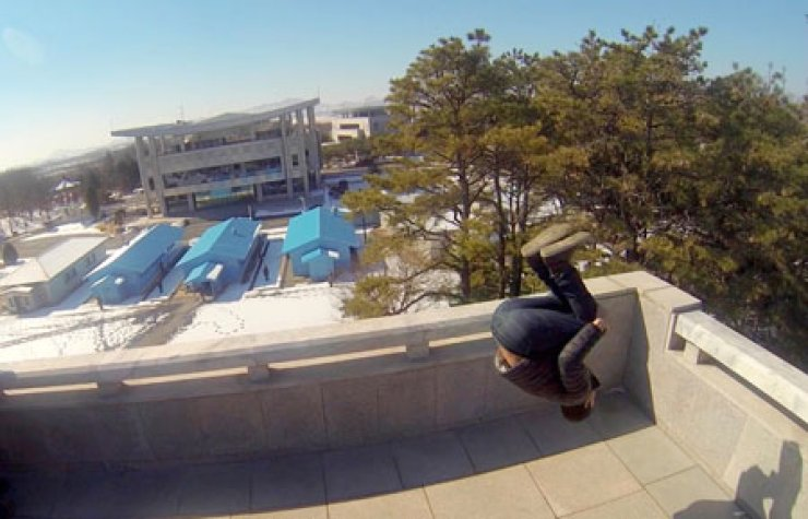 Eric Hill executes a back flip on a deck in the North Korean side of the Demilitarized Zone in this recent photograph.               / Courtesy of Eric Hill