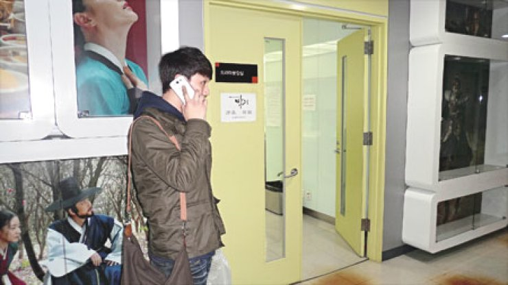Shin Jung-soo works the phones in the corridors of MBC Dream Center where 'King's Doctor' is  filmed.