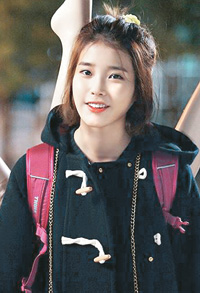 Girls' Generation's Yoona stars in a scene from 'Prime Minister and I' opposite veteran actor Lee Bum-soo.Singer IU in a scene from 'Pretty Boy.' Her co-stars include actor Jang Keun-suk.Uee stars in a scene from the television drama 'GoldenRainbow' /  Korea Times file