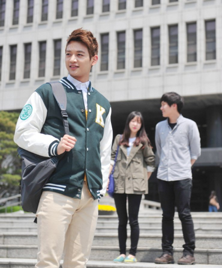 Minho of K-pop boy band SHINee poses for a photograph wearing a baseball jacket with 'K' stitched on the left chest. The letter stands for Konkuk University where he has studied acting since 2010. He was appointed PR ambassador for the school last year. / Korea Times file