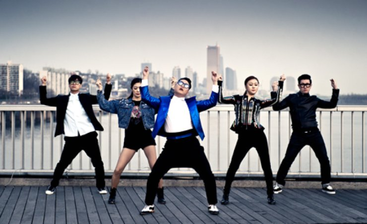 Lee Ju-sun, far left, dances with Psy in this photo captured from the singer's 'Gentleman' music video. The creator of the 'Gangnam Style' horse-riding dance said many choreographers in Korea are wrestling economic trouble.
