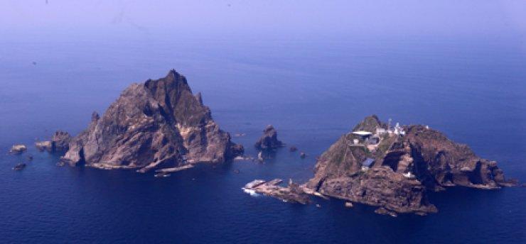 An aerial photo, taken by the Korea Coast Guard, shows Korea's easternmost islets of Dokdo. / Korea Times file