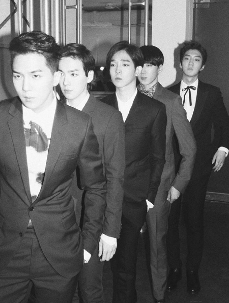 Members of the new K-pop boy band WINNER - Song Min-ho, from front, Kim Jin-woo, Nam Tae-hyun, Kang Seung-yoon and Lee Seung-hoon- pose in this file photo. / Courtesy of YG Entertainment
