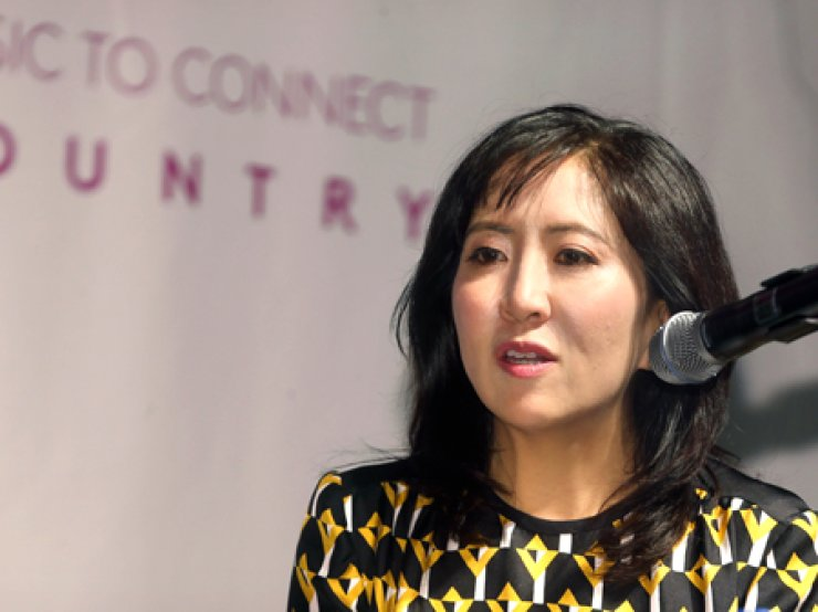 Janice Min, 44, co-president and chief creative director of the Entertainment Group of Guggenheim Media, speaks on the sidlines of the annual music festival the MU:CON Seoul 2014 on Monday in Hannam-dong, Seoul.
