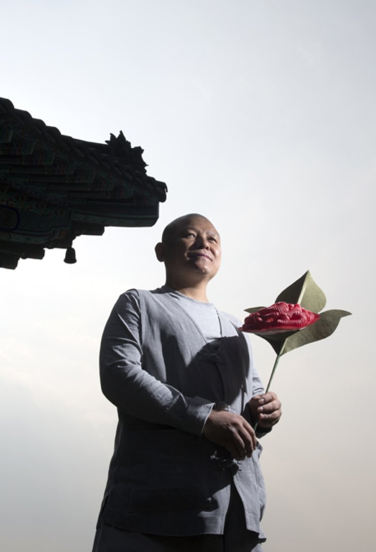 Venerable Sukyong holds a paper flower in Songdeok Temple in Pyeongtaek, Gyeonggi Province. / Korea Times photos by Choi Won-suk