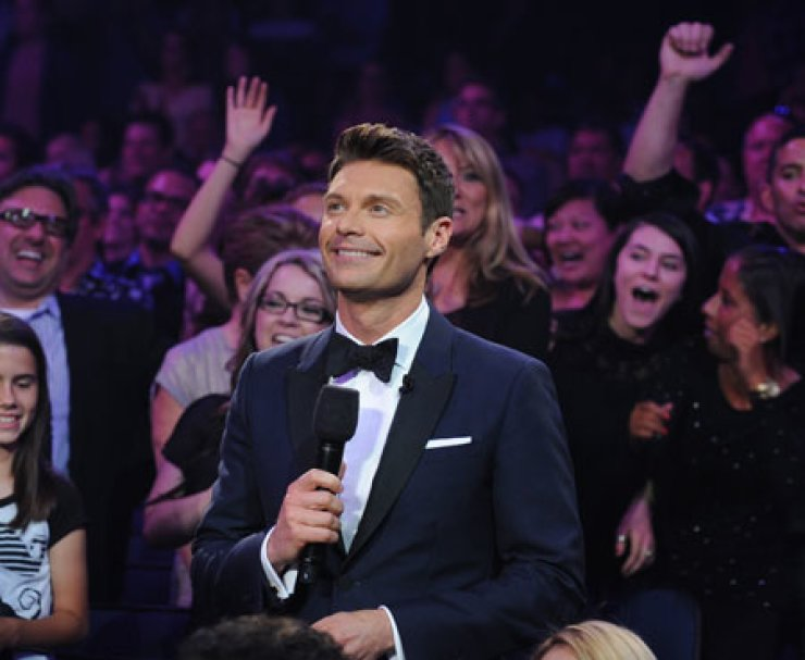 Host Ryan Seacrest appears during the season 12 finale of 'American Idol,' in Los Angeles in this May 16, 2013, file photo. Seacrest was nominated for an Emmy award for outstanding host for a reality, or reality-competition series on Thursday./ AP-Yonhap