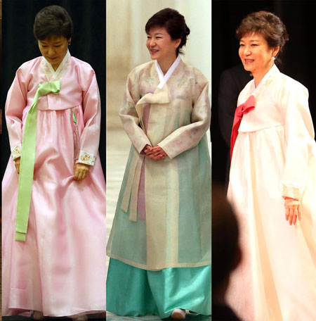 President Park wears Kim Young-seok's deep red-colored topcoat at her inauguration on Feb. 25 this year. / Korea Times file