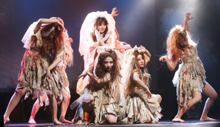 Singer Lee Jung-hyun returns with her new song 'V' after a three-year hiatus at V Hall, in Seogyo-dong, Seoul, on Monday. Lee wears a wedding dress, surrounded by dancers portraying zombies during the performance. Before the performance, her 'Thriller'-like music video, co-directed by brothers, Park Chan-wook, director of movie 'Old Boy,' and Park Chan-gyeong, grabbed the audience attention. / Yonhap