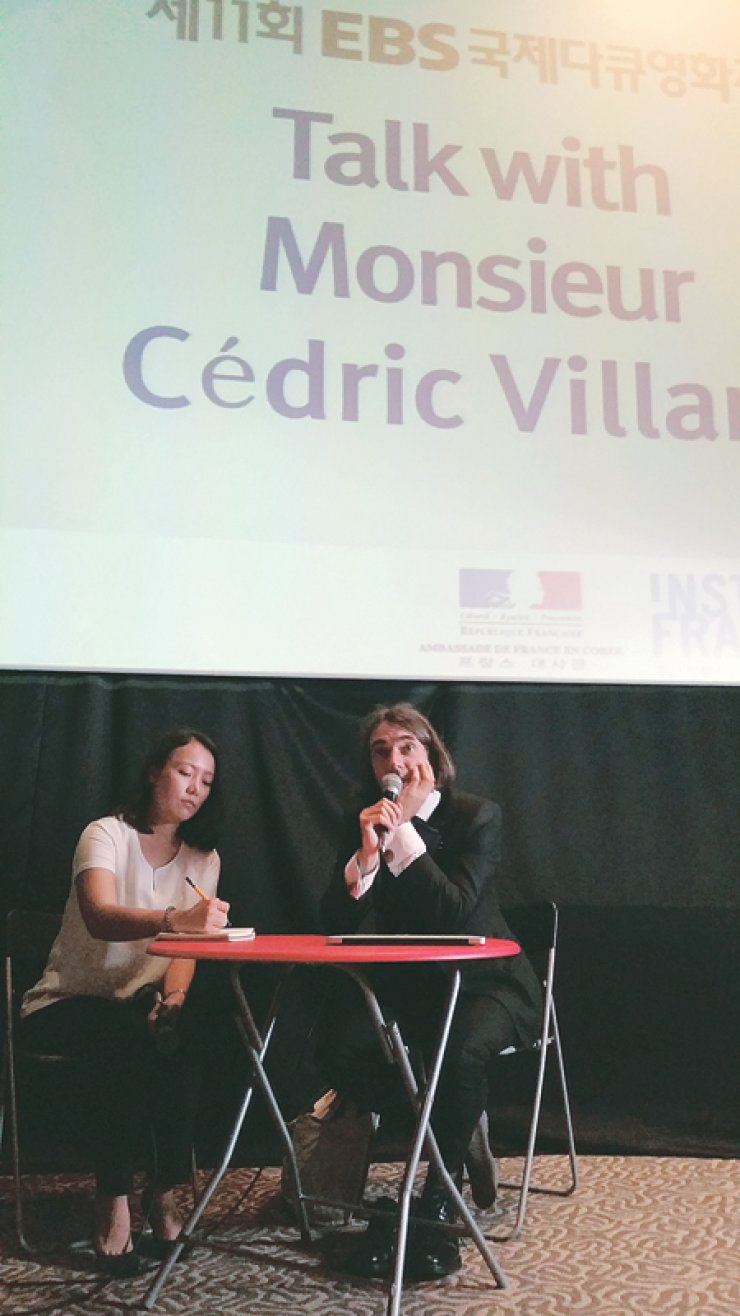 French mathematician Cedric Villani, right, speaks during an open talk with the audience at the Indie Space theater in Seoul, Tuesday. / Korea Times