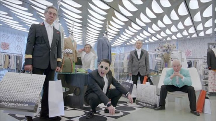 Psy performs in his music video 'Gentleman' at the 10 Corso Como shopping center in Cheongdam, southern Seoul.