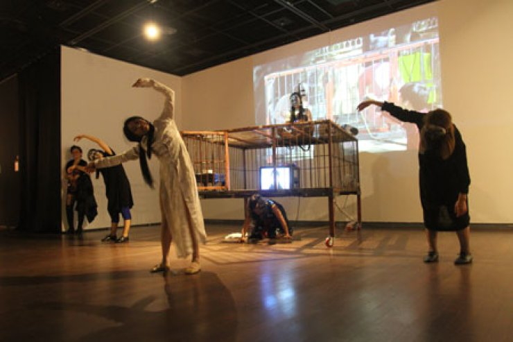 The theater group Saladboom features a play based on the real-life deaths of a group of migrant women at Gimhae Arts and Sports Center on May 28.The troupe is comprised of migrant wives from Asian countries. / Courtesy of Saladboom
