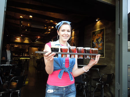 Korrie Mauser, a manager at Reilly's Taphouse, draws a beer from one of 34 taps at the pub in Itaewon, Seoul.