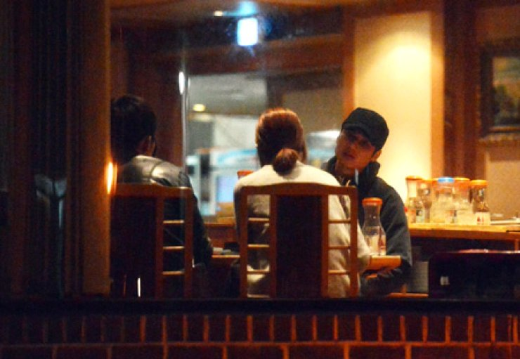 Soccer player Ki Sung-yeung is dating actress Han Hye-jin sitting opposite him in a restaurant in Seoul in this photo released by Dispatch on March 27.