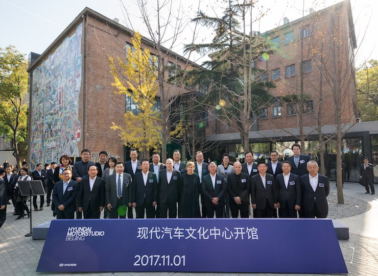Hyundai Motor Vice Chairman Chung Eui-sun, fifth from right in the front row, poses with officials, including Hyundai Motor Studio Beijing designer Michael Rock, fifth from left in the front row, during an opening ceremony of the Hyundai Motor Studio Beijing, Wednesday. / Courtesy of Hyundai Motor