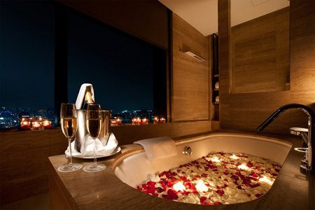 a room in conrad seoul with a bath tub decorated with flower leaves for valentines day courtesy of conrad seoul - Valentine Day Hotel Specials