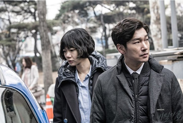 Actor Cho Seung-woo, right, seen from tvN legal thriller 'Stranger.'   /  Courtesy of CJ E&M