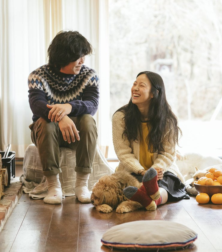 Lee Hyori, right, iconic K-pop singer who leads a makeup free, slow life on Jeju Island, and her husband are seen in this promotional photo for popular reality TV show 'Hyori's Bed & Breakfast.' / Courtesy of JTBC