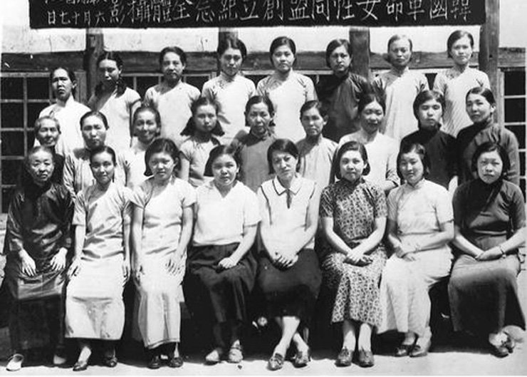 Female freedom fighters of the Korea Revolutionary Women's Alliance, a women's independence movement group, are shown in this black and white photograph. The picture was taken on the alliance's foundation, June 17, 1940, in Chongqing, China. / Courtesy of Ministry of Patriots and Veterans Affairs