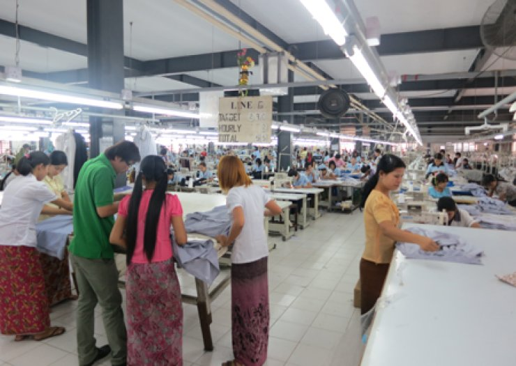 Workers make clothes at a Golden Shine Garment plant in Yangon, Myanmar. A growing number of Korean firms are engaging in mostly labor-intensive sectors and relocating to Myanmar for its cheap labor, abundant natural resources and foreign business-friendly policies./ Courtesy of Korea International Trade Associatio