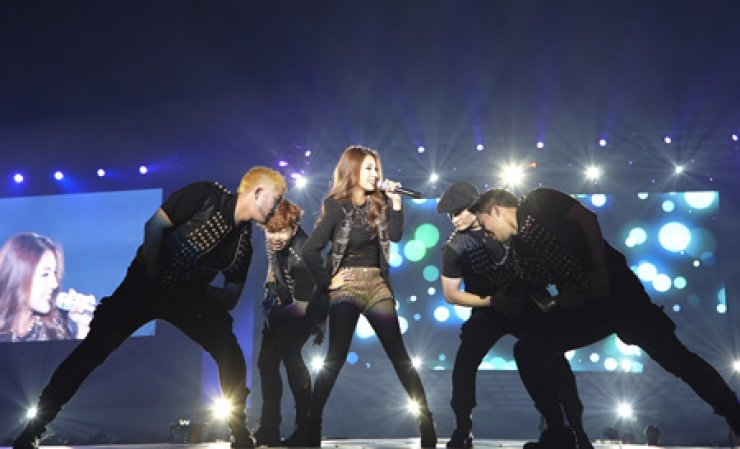 BoA performs on stage at Tokyo Dome as part of the SMTOWN's world tour over the weekend. She and fellow label mates of Kangta, TVXQ, Super Junior, SHINee, EXO, Girls' Generation and others performed for four hours before 100,00 fans on both Saturday and Sunday. / Yonhap