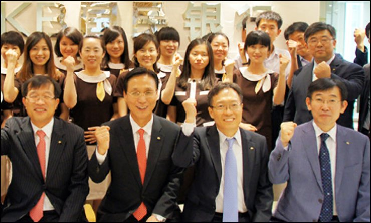 CEO Min Byong-deok, second from left in the first row, poses with employees of KB Kookmin Bank China in his visit to the lender's Chinese unit earlier this week. / Courtesy of KB Kookmin