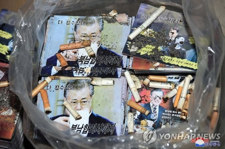 This photo, captured from the website of North Korea's Korean Central News Agency on June 20, 2020, shows printed pictures of South Korean President Moon Jae-in with cigarette butts in a plastic bag, after the North has said it will send anti-Seoul propaganda leaflets from the North into the South. Yonhap