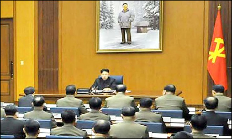 North Korean leader Kim Jong-un presides over a meeting of the Central Military Commission of the ruling Workers' Party. Kim made an 'important' decision regarding the communist state's security and sovereignty at the meeting, a news report said. The (North) Korean Central News Agency did not specify when or where the meeting was held. / Yonhap