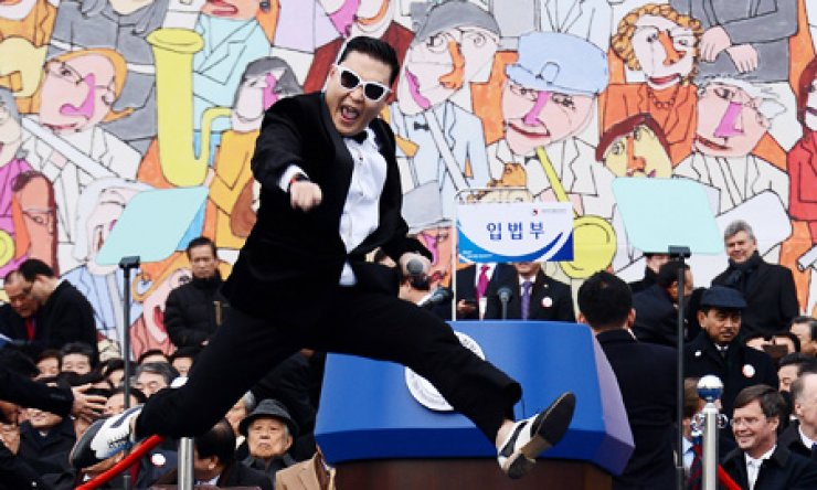 Korean rapper Psy of 'Gangnam Style' fame performs during the inauguration ceremony for President Park Geun-hye in front of the National Assembly building in Yeouido, Seoul, Monday. / Yonhap