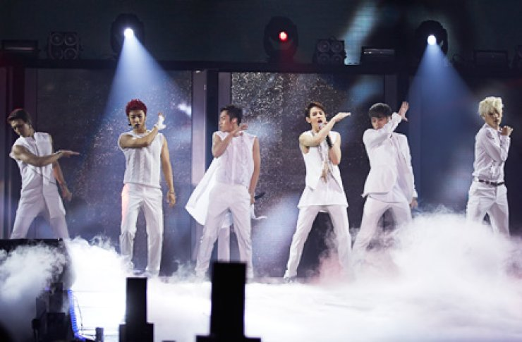 Popular K-pop group BEAST performs its new song 'SHADOW' on stage at the Indoor Gymnasium in the Olympic Park, Bangi-dong, southern Seoul, Sunday. The group released its second full-length studio album, 'Hard to Love, How to Love,' on July 19 in Korea. It will be available in Japan on July 25. The group's leader Yong Joon-hyung, second from right, participated in writing all the songs on the album./ Yonhap