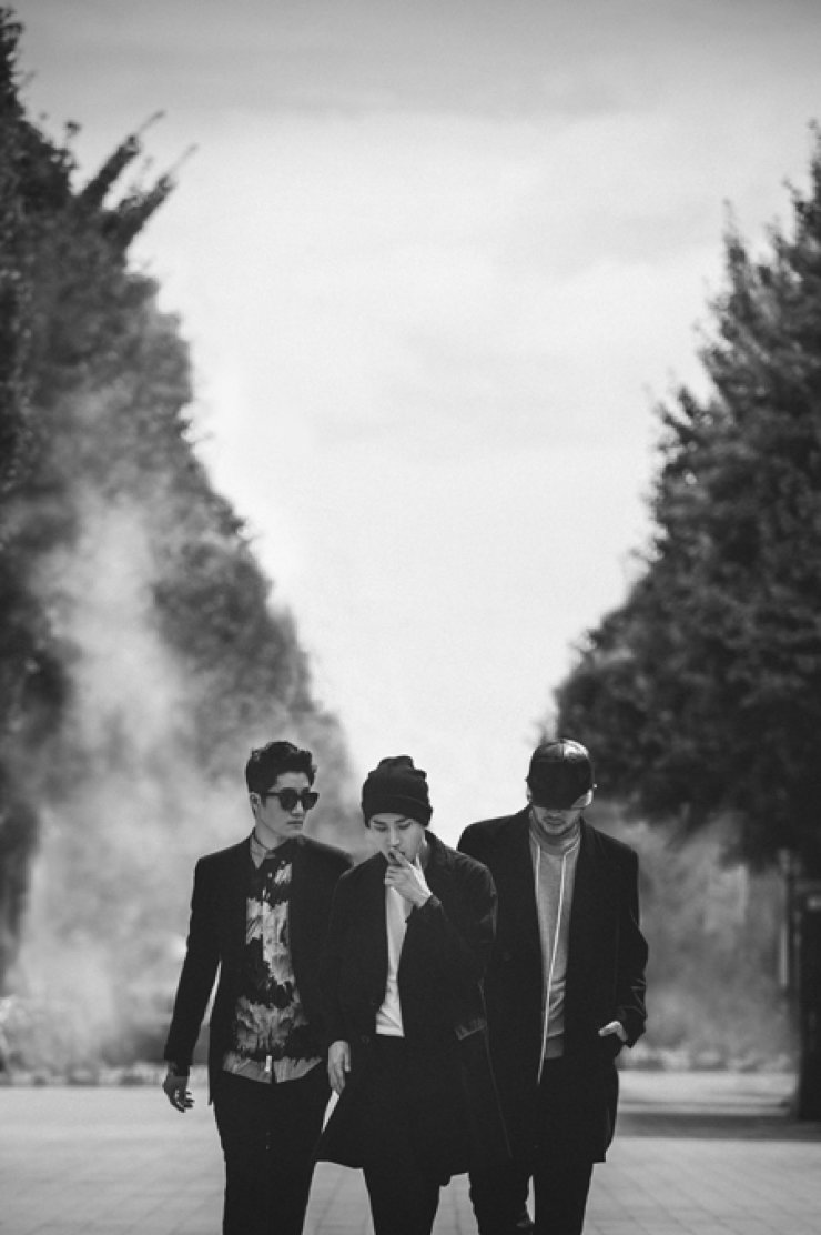DJ Tukutz, from left, Tablo and Mithra Jin pose in this photo to promote therelease of their 8th studio album 'Shoebox.' / Courtesy of YG Entertainment