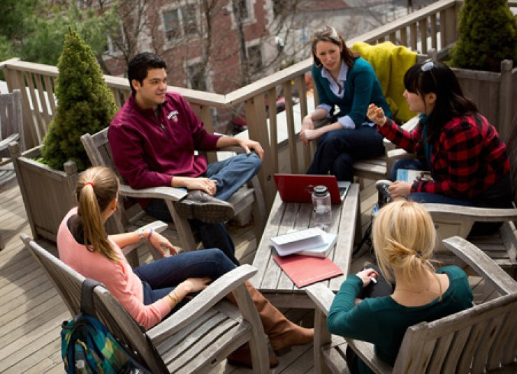 Students chat on the terrace of the Gutman Library on the Harvard Graduate School of Education (HGSE) campus in Massachusetts, in the U.S./ Courtesy of HGSE