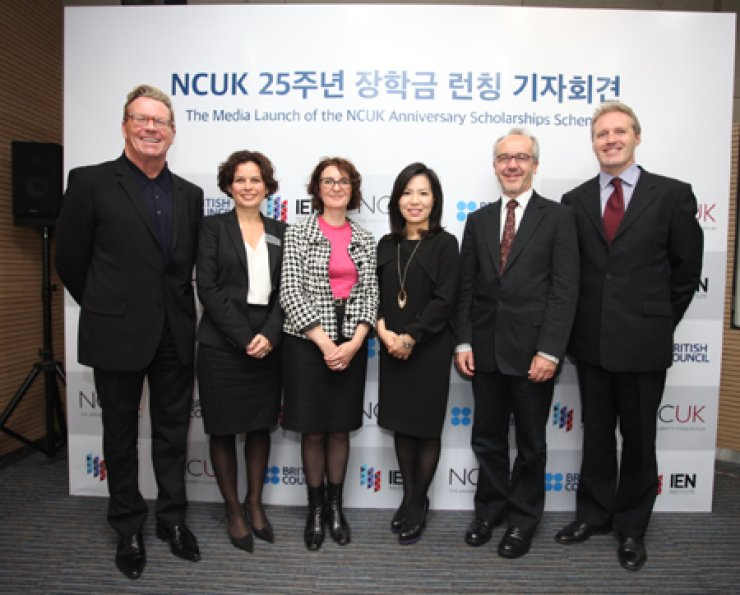 Ken Gil, left, CEO of the Northern Consortium of U.K. Universities (NCUK), poses with Kim Jee-young, fourth from left, principal director of NCUK Korea Center, in the British Council Korea in central Seoul, Tuesday, during a media launch of the NCUK scholarships scheme. Standing with them are Gosia Wells, second from left, director of international office at the University of Sheffield; Piera Gerrard, third from left, marketing director of NCUK; Martin Fryer, second from right, director of the British Council; and Paul Turner, right, Asia-Pacific director of NCUK. / Courtesy of British Council