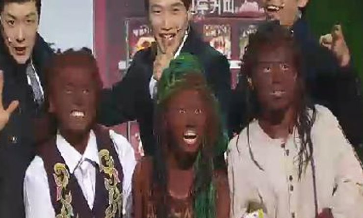 The cast in the KBS television sketch comedy 'Gag Concert' portray black characters in painted faces in the episode that aired Sunday. / Korea Times