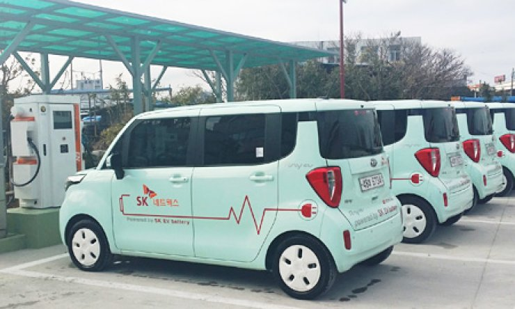 Ray all-electric rental cars are lined up at a charging station on Jeju Island early this year in this file photo.SK Networks is the only company that rents electric cars on the island. / Courtesy of SK Networks