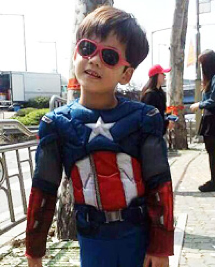 A child in a Captain America costume poses for a photo near Mapo Bridge in western Seoul, Sunday. / Yonhap