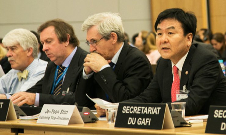 Financial Services Commission Chairman Shin Je-yoon, right, speaks during a plenary meeting of the Financial Action Task Group (FATF) in Paris, Wednesday. / Courtesy of FSC