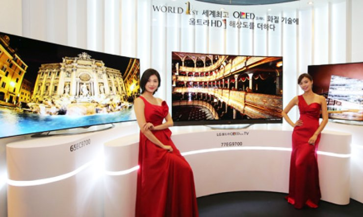 Models promote LG Electronics' new 65-inch Ultra organic light-emitting diode (OLED) TV during a promotional event at the Conrad Seoul Hotel, Monday. / Courtesy of LG Electronics