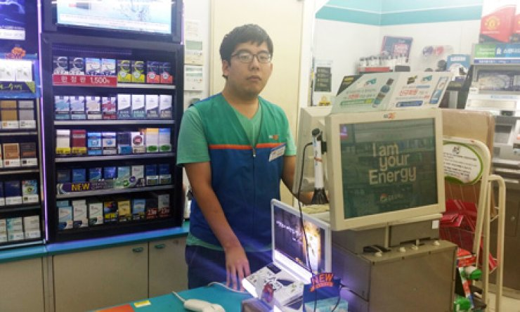 Oh In-hwan, 23, works at the convenience store GS25 in Seoul on Sept. 3.