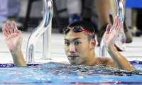 Japanese swimmer expelled over theft