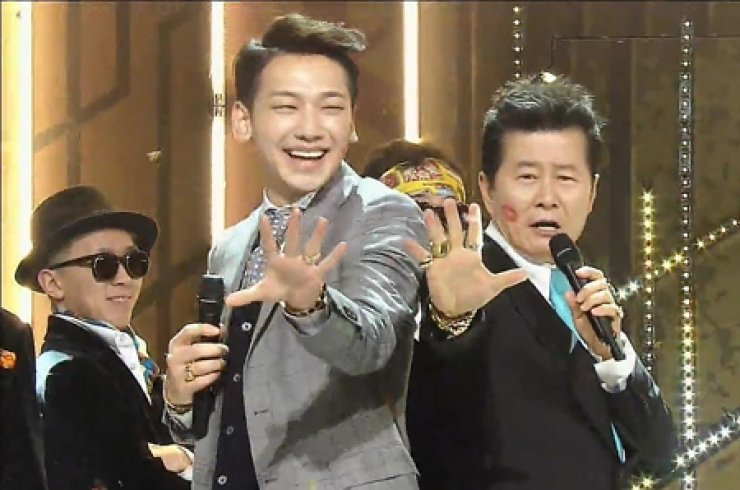 Rain, left, K-pop singer, performs with Tae Jin-ah, veteran trot singer, during an SBS music program in January. / Courtesy of SBS
