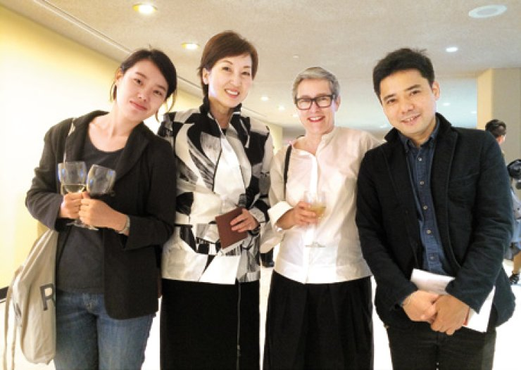 Curator Kim Yu-yeon, second from left, poses with artists participating in the 'Intersections/New Conjunctions' exhibit at the United Nations Headquarters in New York on June 3. The artists are Cha Jae-min from Korea, left, Sabine Bitter from Austria, second from right, and Yuken Teruya from Japan. / Courtesy of Kim Yu-yeon