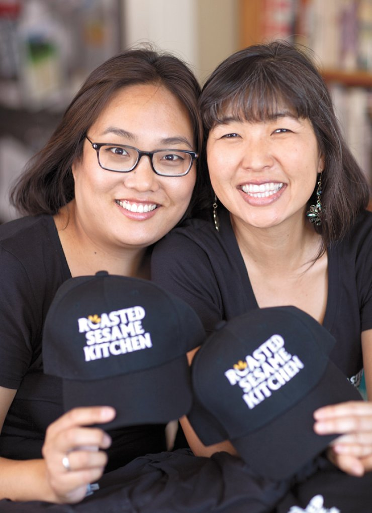 Angela Lee, left, and Cecilia Lee, co-owners of Roasted Sesame Kitchen, a fast-casual bibimbap restaurant in Los Angeles, pose in this file photo. / Courtesy of Roasted Sesame Kitchen
