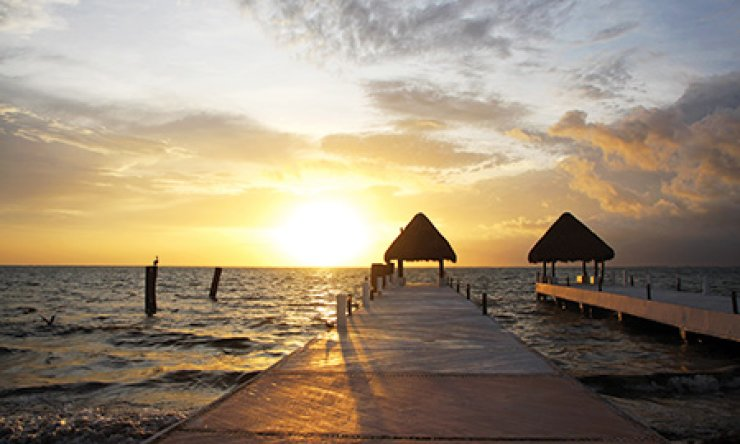 Sunrise at the private beach of Excellence Riviera Maya Resort