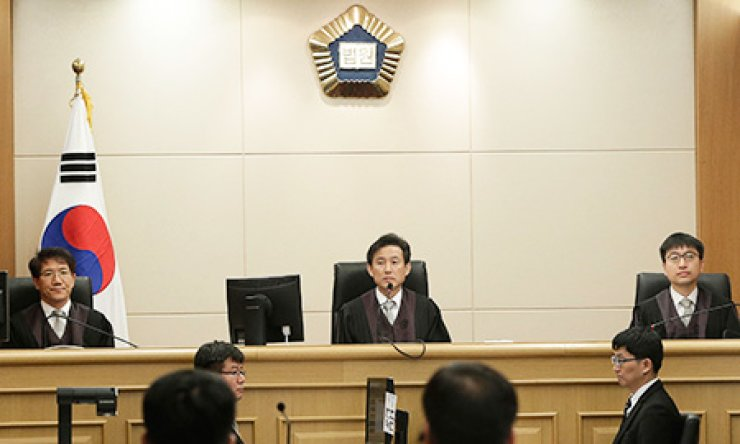 Judges sit to preside over verdicts for the sunken ferry Sewol's crew members who are charged with negligence and abandonment of passengers in the disaster, at the Gwangju High Court in Gwangju, Tuesday. / AP-Yonhap